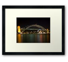 bridge over vivid water Framed Print