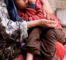 In Her Mother's Arms, Fes Morocco by Debbie Pinard