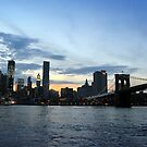 New York City evening skyline with Brooklyn Bridge over Hudson River  by Anton Oparin