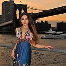 Beautiful girl posing at sunset time under Brooklyn Bridge, NYC by Anton Oparin