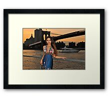 Beautiful girl posing at sunset time under Brooklyn Bridge, NYC Framed Print