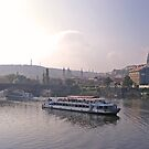 Tour boat late autumn afternoon in Prague by sceneryphotosto
