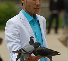 Feeding the Pigeons in Paris, France by Keith Larby