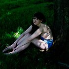 Girl in the grass by Daniyel Lowden