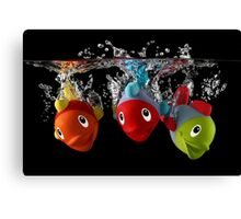 Three Toy Fish With Splash Canvas Print