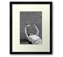 Reading on a summer day Framed Print