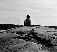 A lady sitting on a rock by Teemu