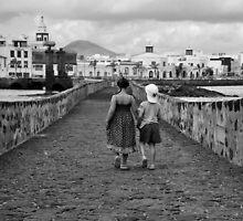 Children walking on a stone bridge by Teemu