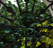 A Lush Garden Framed in a Fence Window Sticker