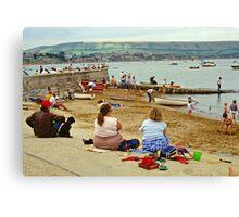 Beach scene, Weymouth, UK., 1980s. Canvas Print