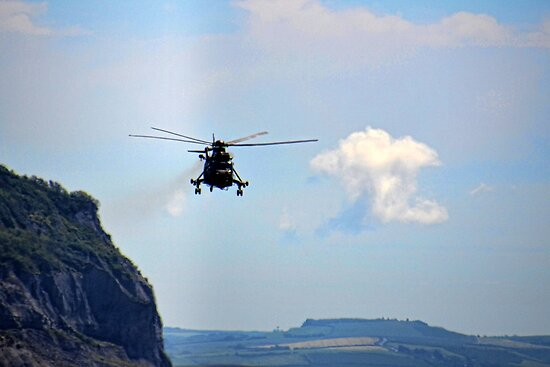 Helicopter Flying Over Charmouth by lynn carter