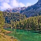 Crystal clear lake in Engadine by Michael Brewer