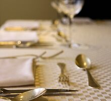 Atmospheric image of a Festive table setting for a formal dinner  by PhotoStock-Isra