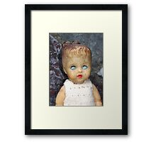 Decaying Doll Framed Print