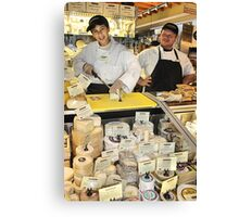 Young Cheese Monger at the Market Canvas Print