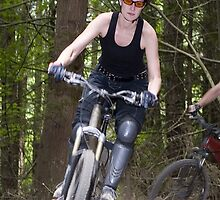 Mountain Biking Woman going downhill by Lisa Kyle Young