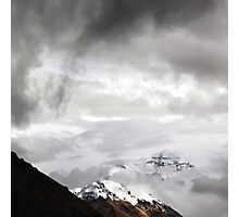 Snowy Mount Everest shines through the clouds Photographic Print