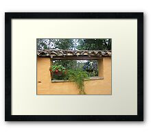 Flowers in the fence Framed Print