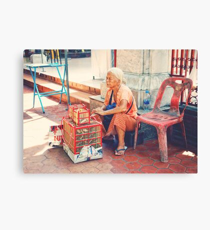 Bird seller Canvas Print