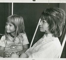 young girl sitting on mothers lap 1970s black and white grunge by Tia Knight