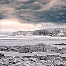 storm clouds with waves by morrbyte