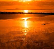 sunset and calm reflections at beal beach by morrbyte