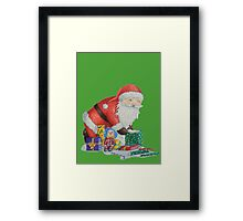 Cute santa and toys wrapping Christmas gifts Framed Print