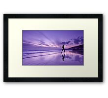 Reflections of a girl on the beach at sunset. Framed Print