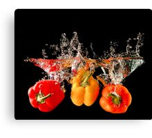 A Splash Of Peppers Canvas Print