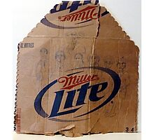 characters drawn on cardboard beer carton Photographic Print