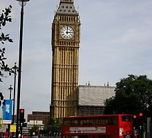 A bus crosses the intersection in front of Big Ben by Joel  Brady