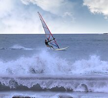 windsurfer windsurfing in a storm by morrbyte