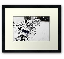 Snow Covered Bicycles Framed Print