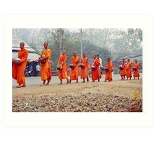 Morning monks line up. Art Print