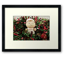A handmade baby doll in tinsel Framed Print