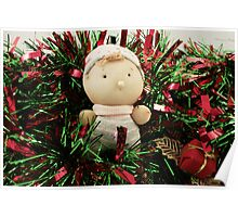 A handmade baby doll in tinsel Poster