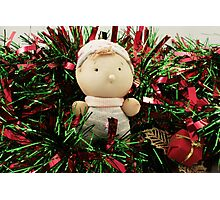A handmade baby doll in tinsel Photographic Print