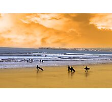 young surfers walking on sunset beach Photographic Print