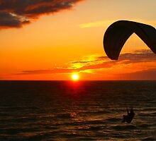 Paragliding, the sun sets by pilsetnieks