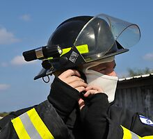 Portrait of a fire fighter in fire resistant clothes  by PhotoStock-Isra