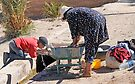 Woman Washing, Boy Drinking, Skoura Morocco by Debbie Pinard
