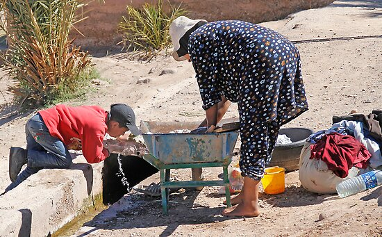 Woman Washing, Boy Drinking, Skoura Morocco by Debbie Pinard