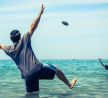 Frisbee at the beach by Erin Fitzgibbon