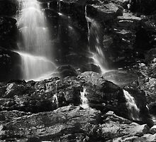 Snowmelt Waterfalls by Roupen  Baker