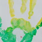 Yellow and Green Handprint by The Street Child Project