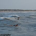 Surfing on Padre Island by Roschetzky