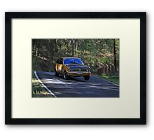 Datto 120 Lifting a Wheel Framed Print