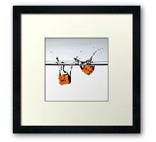 Orange dices Framed Print