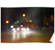 Abstract blurry spots of light in the night city street Poster