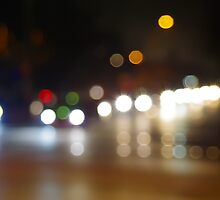 Abstract blurry spots of light in the night city street scene by vladromensky